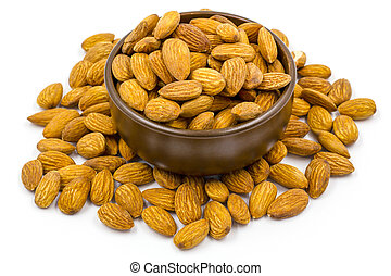 Almonds with bowl on the white background.