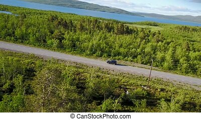Almost crash quadrocopter on Norwegian road in the mountains. Aerial view