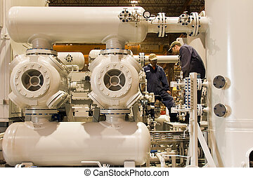 Natural Gas compressor station with workers