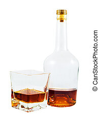 Almost empty bottle and glass of whiskey