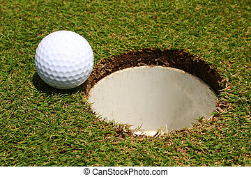 Almost There - A golf ball on the edge of a hole