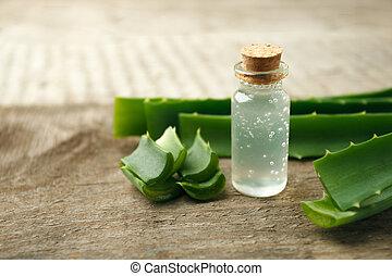 Aloe vera essential oil on vintage wooden background
