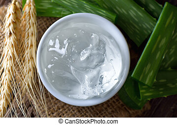 aloe vera gel in bowl with on wooden table