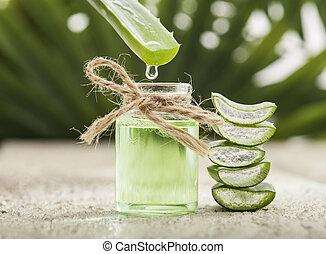 Aloe Vera Leaves - Aloe vera essential oil on tropical...