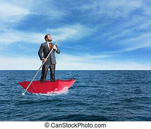 Alone businessman in the sea