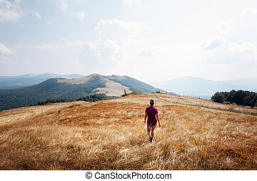 Alone girl in autumn mountains