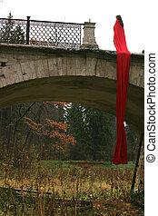 alone girl in fall park in old bridge