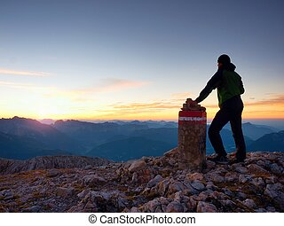 Alone hiker against of Austria Germany border stone on ...