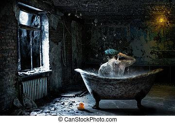 Alone sad man taking bath in abandoned room at night