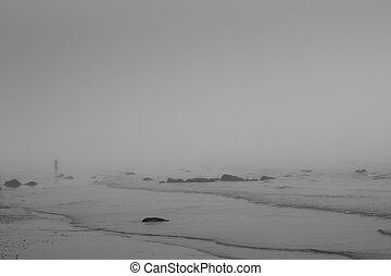 Alone on a misty winter beach