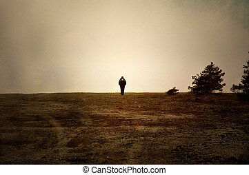 Image textured with soft sandstone of human walking alone on a moor.