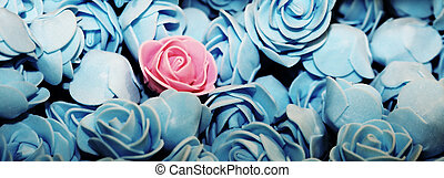 Alone pink rose on the many blue roses