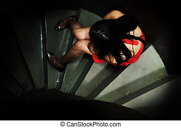 Alone sad abandoned lady crying on steps in dark