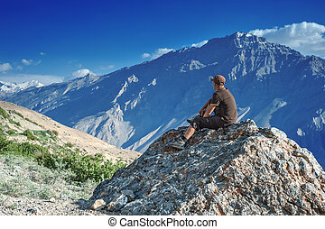 top - alone tourist on mountain top