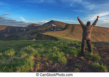 top - alone tourist on mountain top