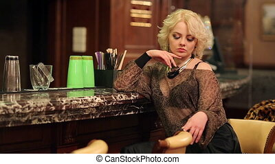 Alone Woman in a Bar