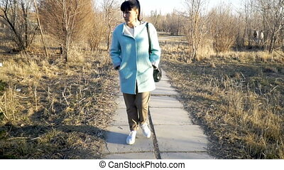 Alone woman walking in the park
