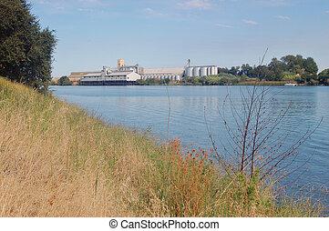 Grain storing depot along the Sacramento River Delta, California.