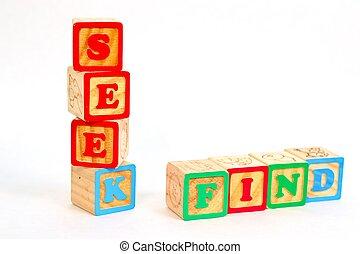 Vintage alphabet blocks spelling out SEEK and FIND