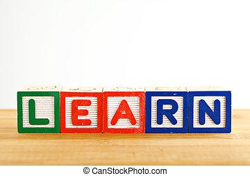 Alphabet Block spell the word learn