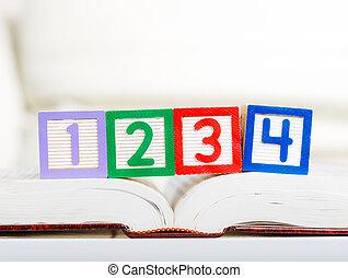 Alphabet block with 1234 on book