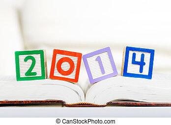 Alphabet block with 2014 on book