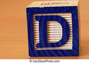 Alphabet block with a blue letter D