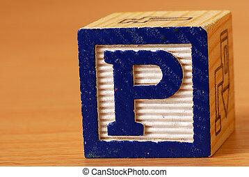 Alphabet block with a blue letter P