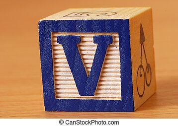 Alphabet block with a blue letter V