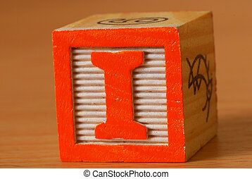 Alphabet block with a red letter I