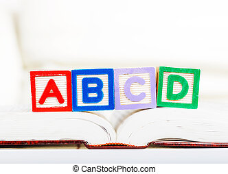Alphabet block with ABCD on book