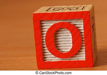 Alphabet block with an orange Letter O
