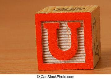 Alphabet block with an orange letter U
