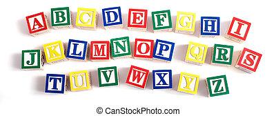 A child's alphabet blocks on a white background