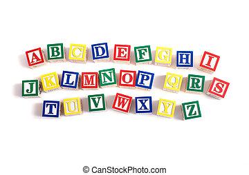 Alphabet Blocks - A child\'s alphabet blocks on a white...