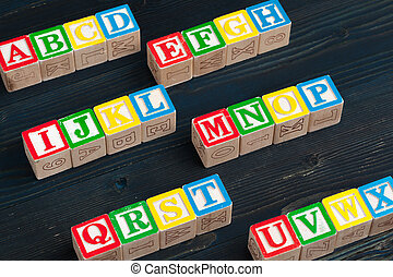 Alphabet blocks ABC on wooden table. creative photo.