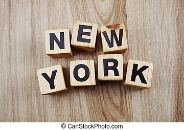 alphabet blocks letters new york on wood background