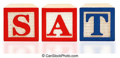 Scholastic Assessment Test SAT alphabet blocks over white background.