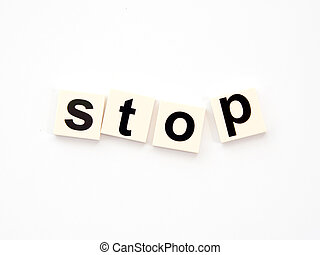 alphabet blocks words stop, standing in a row on a reflective white background