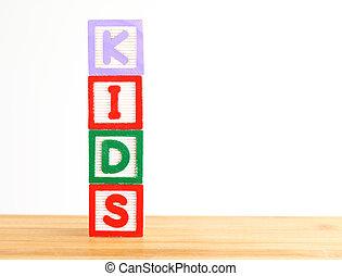 Alphabet building blocks that spelling the word kids