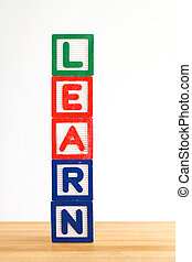 Alphabet building blocks that spelling the word learn