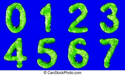 Alphabet from green water isolated on a blue background. The...