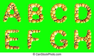 Alphabet from oil bubble isolated on a green background. The...