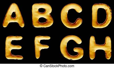 Alphabet from oil isolated on a black background. The letter...