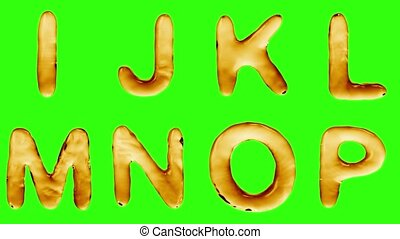 Alphabet from oil isolated on a green background. The letter...