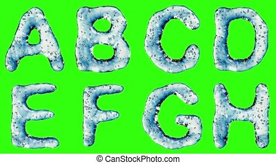 Alphabet from water isolated on a green background.