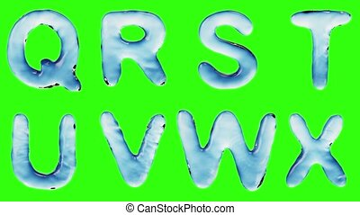Alphabet from water isolated on a green background. The...