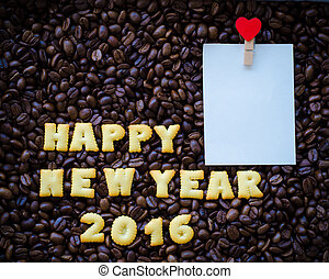 "alphabet "" happy new year 2016"" made from bread cookies on coffee beans background"