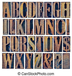 alphabet in modern letterpress wood type printing blocks, a collage of 26 isolated letters, question mark, exclamation point, ampersand and dollar sign