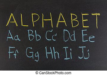 alphabet in capitals written with chalk on a blackboard.